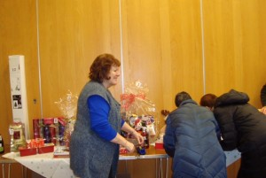 Jill Brudney sticking winner numbers to the prizes